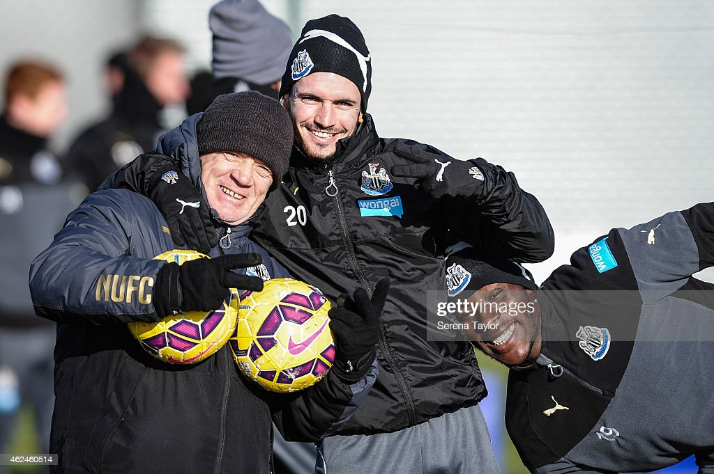 Newcastle's Kit/equipment assistant Neil Stoker (L) Remy Cabella (C) and Massadio Haidara smile for the camera during a training session at The Newcastle United Training Centre on January 29, 2015, in Newcastle upon Tyne, England.