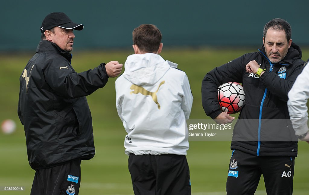 Newcastle's Manager Rafael Benitez (L) gives instructions to Coaches Francisco De Miguel Moreno (C) and Antonio Gomez Perez (R) during the Newcastle United Training session at The Newcastle United Training Centre on May 6, 2016, in Newcastle upon Tyne, England.