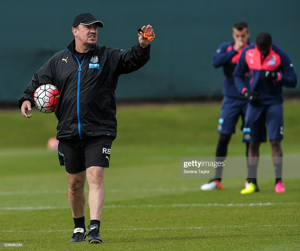 Newcastle's Manager Rafael Benitez (L) holds a ball under his arm and points instructions during the Newcastle United Training session at The Newcastle United Training Centre on May 6, 2016, in Newcastle upon Tyne, England.