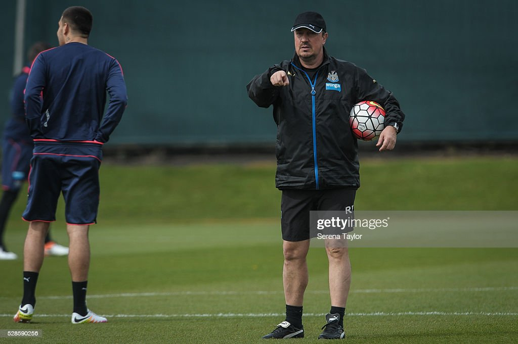 Newcastle's Manager Rafael Benitez (R) holds a ball under his arm and points instructions during the Newcastle United Training session at The Newcastle United Training Centre on May 6, 2016, in Newcastle upon Tyne, England.