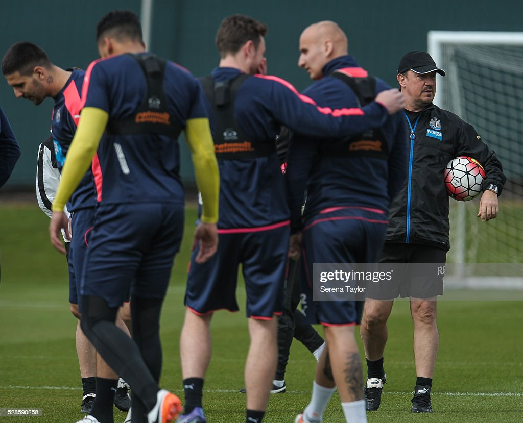 Newcastle's Manager Rafael Benitez (R) holds a ball under his arm during the Newcastle United Training session at The Newcastle United Training Centre on May 6, 2016, in Newcastle upon Tyne, England.