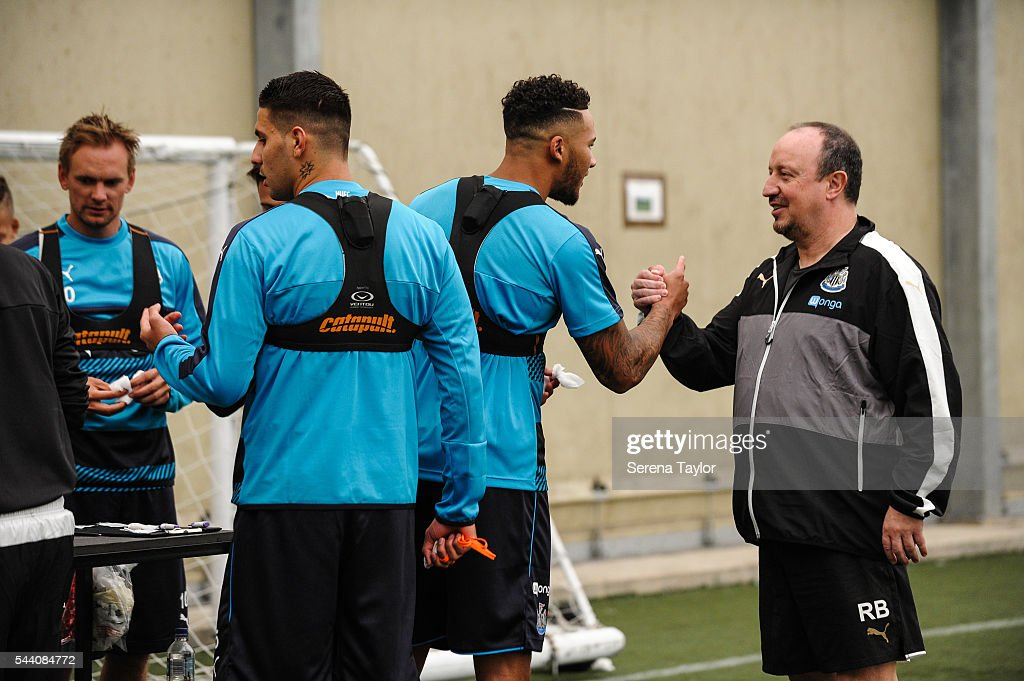 Newcastle's Manager Rafael Benitez (R) shakes hands with Jamaal Lascelles during the fitness testing on the first day back at The Newcastle United training Centre on July 1, 2016 in Newcastle upon Tyne, England.