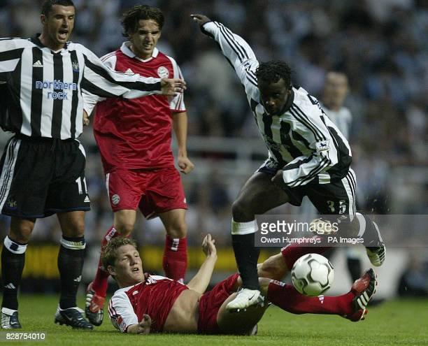 Newcastles Oliver Bernard battles with Bayern Munich's Bastian Schweinsteiger during their preseason friendly at St James' Park Newcastle THIS...