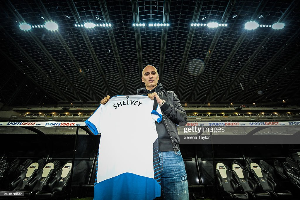 Newcastle's second January signing <a gi-track='captionPersonalityLinkClicked' href=/galleries/search?phrase=Jonjo+Shelvey&family=editorial&specificpeople=4940315 ng-click='$event.stopPropagation()'>Jonjo Shelvey</a> poses for photographs holding a Newcastle shirt with his name on the back at St.James' Park on January 12, 2016, in Newcastle upon Tyne, England.