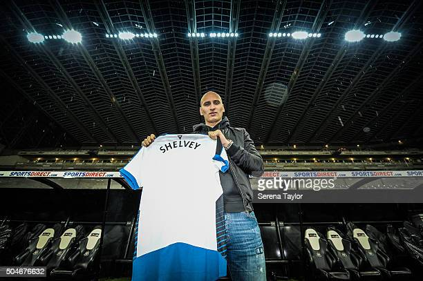 Newcastle's second January signing Jonjo Shelvey poses for photographs holding a Newcastle shirt with his name on the back at StJames' Park on...