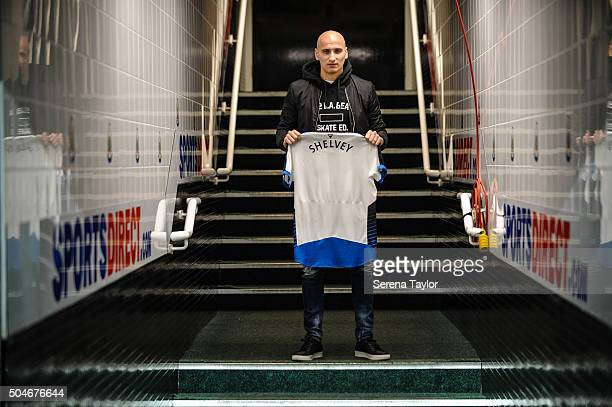 Newcastle's second January signing Jonjo Shelvey poses for photographs in the tunnel holding a Newcastle shirt with his name on the back at StJames'...