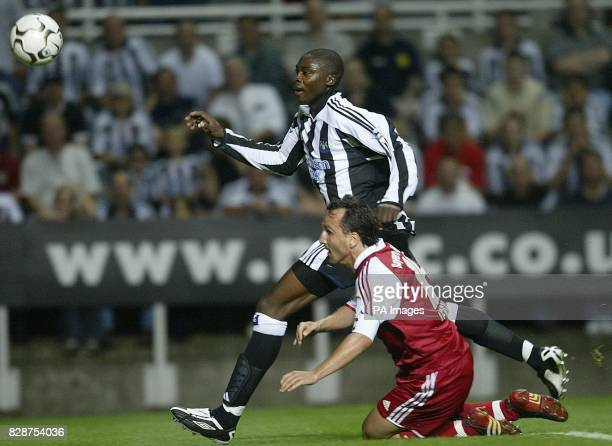 Newcastle's Shola Ameobi battles with Bayern Munich's Jens Jeremies during their preseason friendly at St James' Park Newcastle Tuesday August 5 2003...