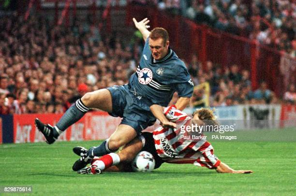 Newcastle's Steve Watson is brought down by Sunderland's Michael Gray during this evenig's Premier League match at Roker Park Photo by Paul Barker/PA