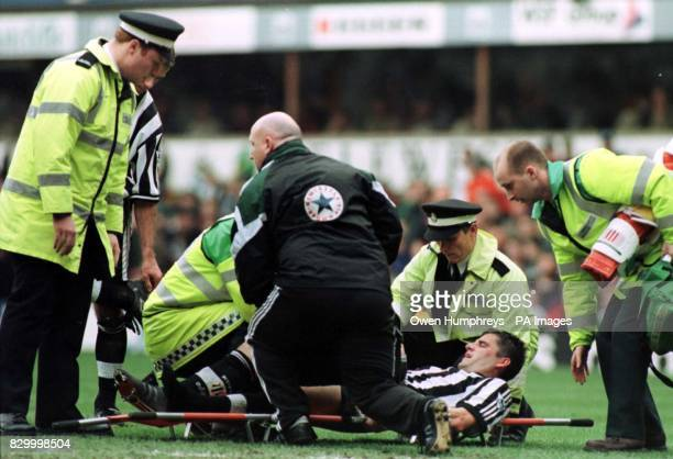 Newcastle's United's defender Philippe Albert is stretchered of with a suspected broken ankle during their FA Carling Premiership match against...