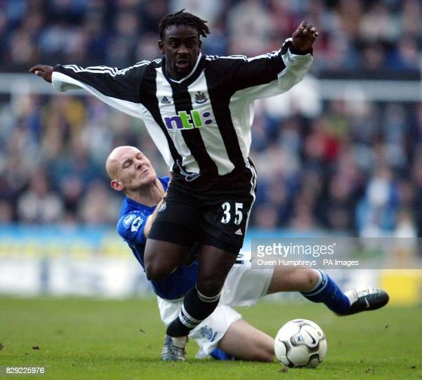 Newecastle United's s Oliver Bernard is tripped by Everton's Thomas Gravesen during their FA Barclaycard Premiership match at Newcastle's St James'...