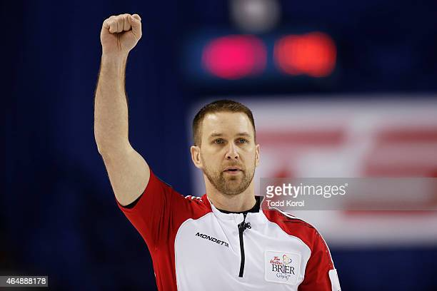 Newfoundland and Labrador skip Brad Gushue celebrates after he defeated Team Canada during the Tim Horton's Brier at the Scotiabank Saddledome on...