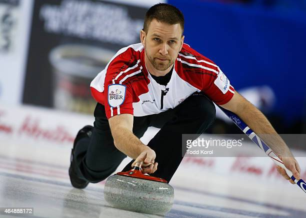Newfoundland and Labrador skip Brad Gushue delivers his shot inches game against Team Canada during the Tim Horton's Brier at the Scotiabank...