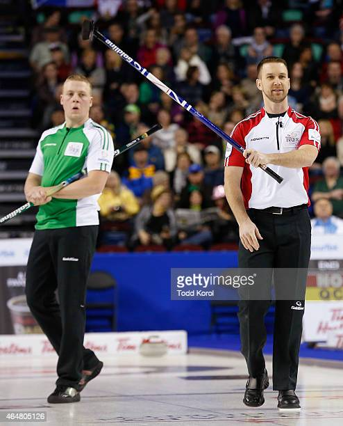 Newfoundland and Labrador skip Brad Gushue reacts to his shot in front of Saskatchewan second Colton Flasch during the Tim Horton's Brier at the...