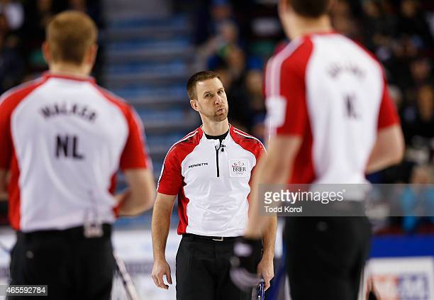 Newfoundland and Labrador skip Brad Gushue reacts to his teammates lead Geoff Walker and second Brett Gallant after his shot in the bronze medal game...