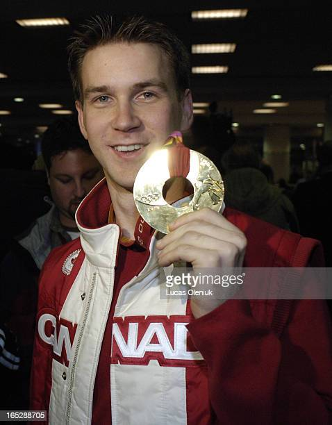 Newfoundland skip Brad Gushue shows off his gold medal Monday afternoon after arriving in Toronto fresh off of his team's Olympic victory in Turin