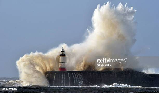 Newhaven lighthouse is battered by waves as high winds from the lastest winter storm continue in Newhaven on the south coast of England on February...