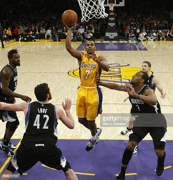 Newly acquired Laker point guard Ramon Sessions makes his first shot as a Laker past Timberwolves' Martell Webster #5 left Kevin Love #42 and Derrick...