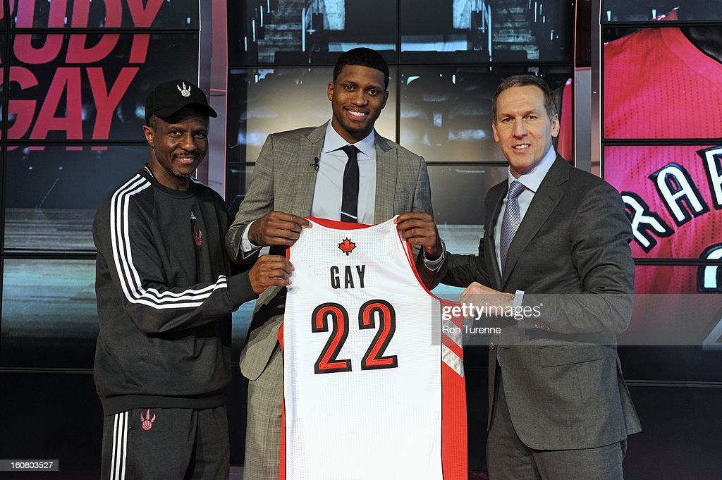 Newly acquired Rudy Gay of the Toronto Raptors with Dwane Casey and Bryan Colangelo of the Toronto Raptors during a press conference to announce his acquisition to the Toronto Raptors on February 1, 2013 at the Air Canada Centre in Toronto, Ontario, Canada.