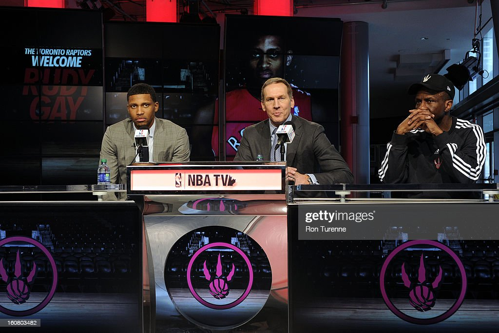 Newly acquired Rudy Gay of the Toronto Raptors with General Manager Bryan Colangelo and Head Coach Dwane Casey attend a press conference to announce his acquisition to the Toronto Raptors on February 1, 2013 at the Air Canada Centre in Toronto, Ontario, Canada.