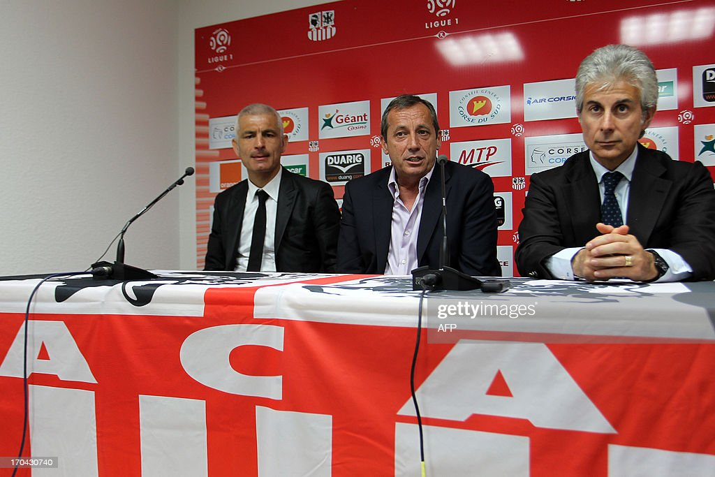 Newly appointed Ajaccio football club head coach, Italy's Fabrizio Ravanelli (L) Ajaccio's president Alain Orsoni (C) and assistant coach Giampiero Ventrone give a press conference on June 13, 2013 in Ajaccio, during Ravanelli's official presentation.