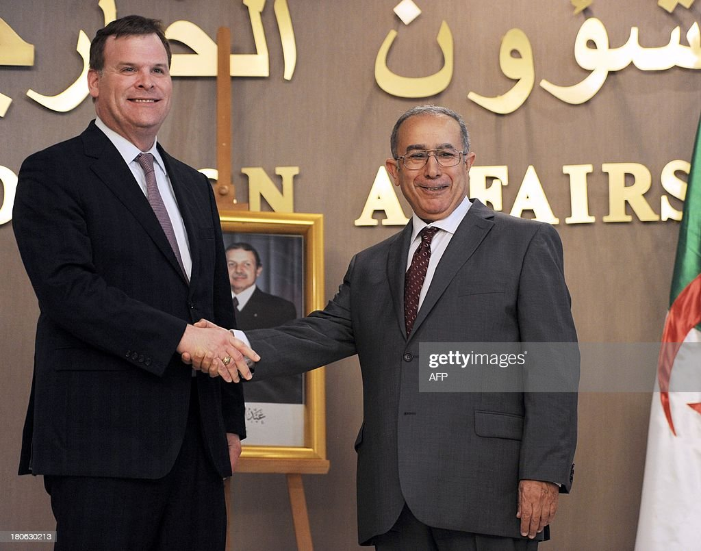 Newly appointed Algerian Foreign Affairs Minister Ramtane Lamamra (R) shakes hands with his Canadian counterpart <a gi-track='captionPersonalityLinkClicked' href=/galleries/search?phrase=John+Baird+-+Canadian+Politician&family=editorial&specificpeople=10720753 ng-click='$event.stopPropagation()'>John Baird</a> during a press conference at the Ministry of Foreign Affairs in Algiers, on September 15, 2013. Baird visits Algeria for bilateral meetings with Abdelmalek Sellal, Algerias Prime Minister, and Ramtane Lamamra. AFP PHOTO / FAROUK BATICHE
