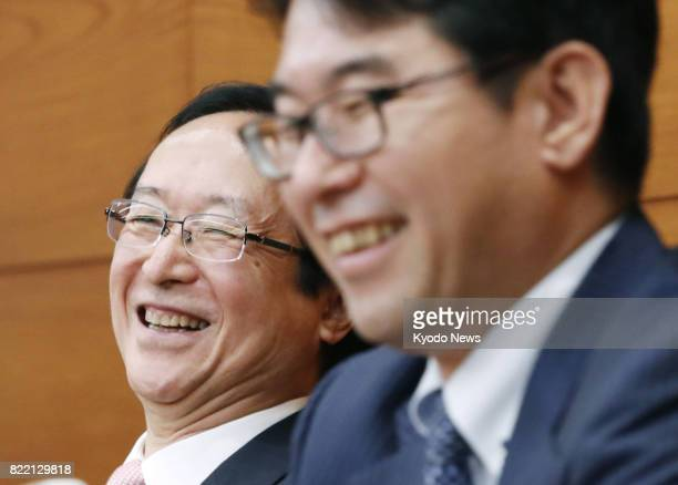 Newly appointed Bank of Japan Policy Board members Goshi Kataoka and Hitoshi Suzuki hold a news conference at the central bank's headquarters in...