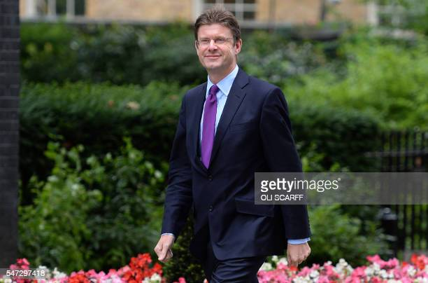 Newly appointed British Business Energy and Industrial Strategy Secretary Greg Clark arrives in Downing Street in central London on July 14 as...