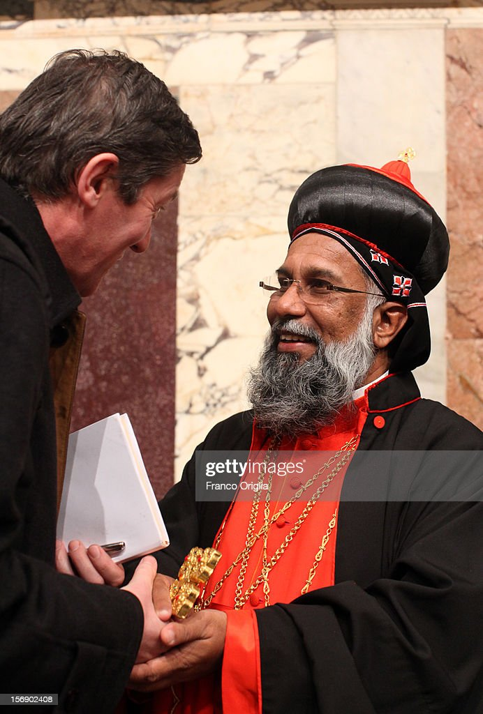 Newly appointed cardinal Baselios Cleemis Thottunkal (R) receives congratulations during the courtesy visits at the Sala del Trono Hall at the end of the concistory held by Pope Benedict XVI on November 24, 2012 in Vatican City, Vatican. The Pontiff installed 6 new cardinals during the ceremony, who will be responsible for choosing his successor.