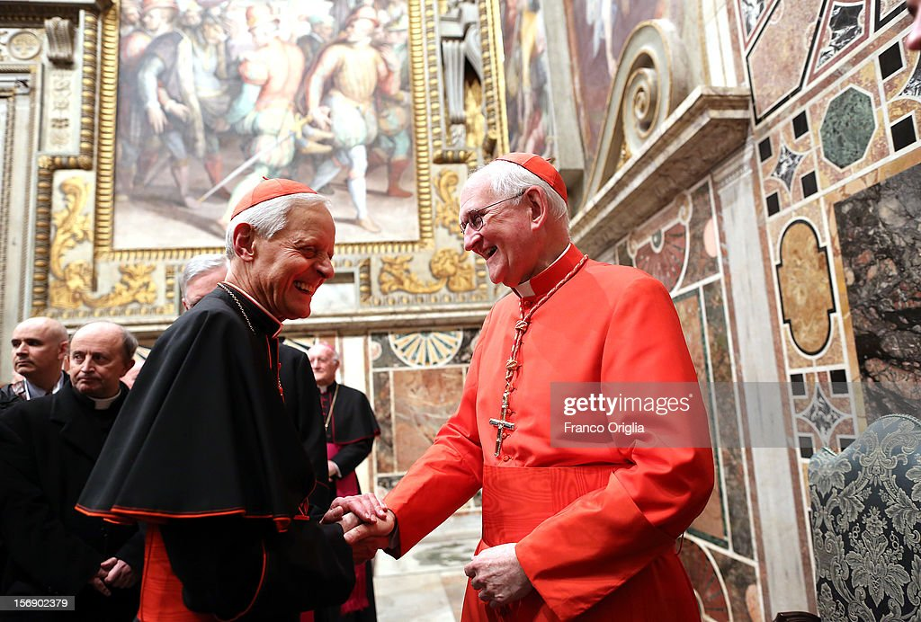 Newly appointed cardinal James M. Harvey (R) receives congratulations from Archbishop of Washington Cardinal Donald Wuerl (L) during the courtesy visits at the Sala del Trono Hall at the end of the concistory held by Pope Benedict XVI on November 24, 2012 in Vatican City, Vatican. The Pontiff installed 6 new cardinals during the ceremony, who will be responsible for choosing his successor.