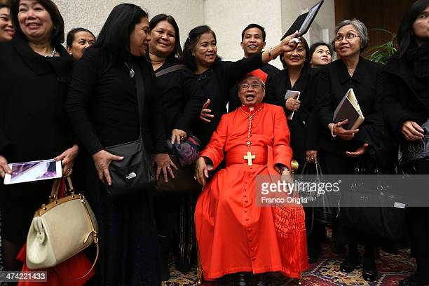 Newly appointed cardinal Orlando B Quevedo of the Philippines takes a picture with his diocesans during a courtesy visit on February 22 2014 in...
