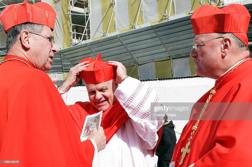 Newly appointed cardinals Timothy Michael Dolan (R) archbishop of New York and cardinal Frederick O'Brien (C) archbishop of Baltimora receive congratulations from cardinal <a gi-track='captionPersonalityLinkClicked' href=/galleries/search?phrase=Roger+Mahony&family=editorial&specificpeople=664416 ng-click='$event.stopPropagation()'>Roger Mahony</a> (L) former archbishop of Los Angeles, as they leave Saint Peter's Basilica after a ceremony held by Pope Benedict XVI on February 18, 2012 in Vatican City, Vatican. The 84 year old Pontiff installed 22 new cardinals during the ceremony, who will be responsible for choosing his successor.