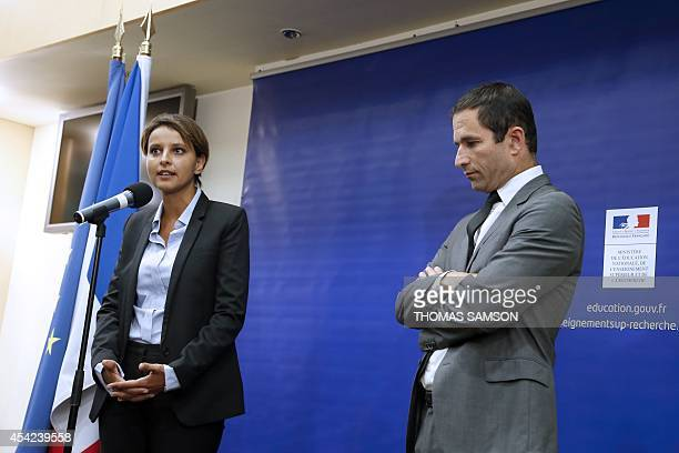 Newly appointed Education minister Najat VallaudBelkacem delivers a speech eyed by her predecessor Benoit Hamon during the handover ceremony at the...
