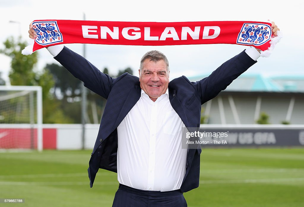 Newly appointed England manager Sam Allardyce poses after a press conference at St George's Park on July 25 2016 in BurtonuponTrent England