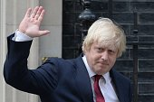 Newly appointed Foreign Secretary Boris Johnson waves as he leaves 10 Downing Street in central London on July 13 2016 after new British Prime...