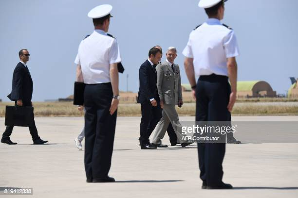 Newly appointed French chief of military staff General Francois Lecointre walks along side French President Emmanuel Macron during his visit to the...