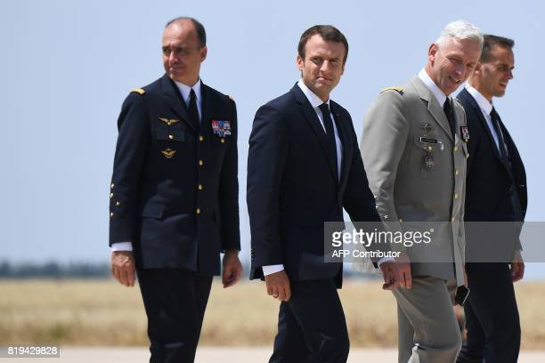 Newly appointed French chief of military staff General Francois Lecointre walks along side French President Emmanuel Macron during a visit to the...