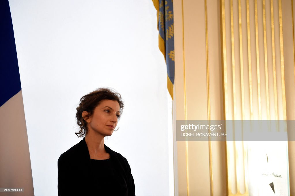 Newly appointed French Culture minister Audrey Azoulay (L) listens as former French Culture minister Fleur Pellerin (not pictured) speaks at the Culture ministry in Paris on February 12, 2016 during the transferal of powers. Audrey Azoulay was named new French Culture minister as French President Francois Hollande reshuffled his cabinet on February 11, 2016, naming Jean-Marc Ayrault foreign minister and adding several ecologists to government as he seeks to widen his political base ahead of a presidential poll in 2017. AFP PHOTO / LIONEL BONAVENTURE / AFP / LIONEL BONAVENTURE