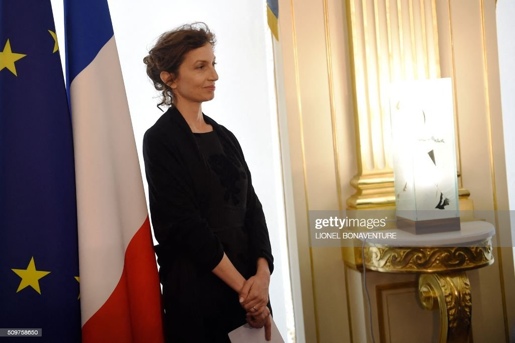Newly appointed French Culture minister Audrey Azoulay listens as former French Culture minister Fleur Pellerin (not pictured) speaks at the Culture ministry in Paris on February 12, 2016 during the transferal of powers. Audrey Azoulay was named new French Culture minister as French President Francois Hollande reshuffled his cabinet on February 11, 2016, naming Jean-Marc Ayrault foreign minister and adding several ecologists to government as he seeks to widen his political base ahead of a presidential poll in 2017. AFP PHOTO / LIONEL BONAVENTURE / AFP / LIONEL BONAVENTURE