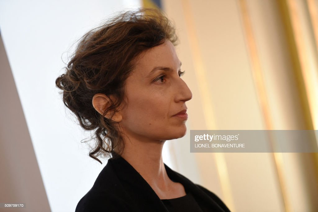 Newly appointed French Culture minister Audrey Azoulay listens at fomer French Culture minister Fleur Pellerin (not pictured)at the Culture ministry in Paris on February 12, 2016 during the transferal of powers. Audrey Azoulay was named new French Culture minister as French President Francois Hollande reshuffled his cabinet on February 11, 2016, naming Jean-Marc Ayrault foreign minister and adding several ecologists to government as he seeks to widen his political base ahead of a presidential poll in 2017. AFP PHOTO / LIONEL BONAVENTURE / AFP / LIONEL BONAVENTURE