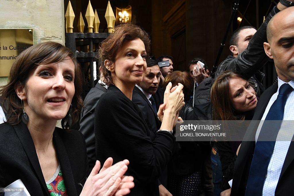 Newly appointed French Culture minister Audrey Azoulay stands at the entrance of the Culture ministry in Paris on February 12, 2016. Audrey Azoulay was named new French Culture minister as French President Francois Hollande reshuffled his cabinet on February 11, 2016, naming Jean-Marc Ayrault foreign minister and adding several ecologists to government as he seeks to widen his political base ahead of a presidential poll in 2017. AFP PHOTO / LIONEL BONAVENTURE / AFP / LIONEL BONAVENTURE