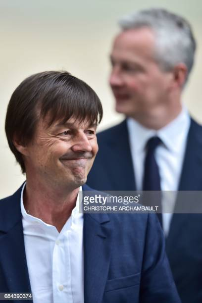 Newly appointed French Economy minister Bruno Le Maire and French Minister of the Ecological and Social Transition Nicolas Hulot leave the Elysee...