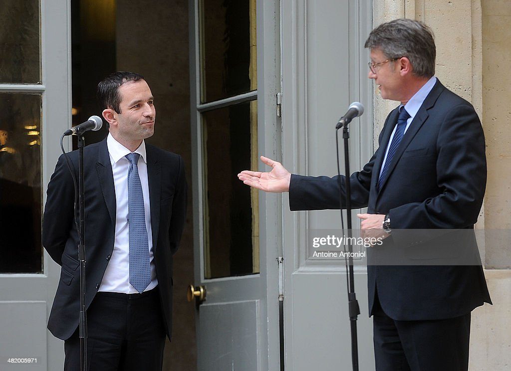 Newly appointed French Education Minister Benoit Hamon (L) listens as outgoing French Education Minister <a gi-track='captionPersonalityLinkClicked' href=/galleries/search?phrase=Vincent+Peillon&family=editorial&specificpeople=2150233 ng-click='$event.stopPropagation()'>Vincent Peillon</a> speaks during a ceremony at the Ministry of Education on April 2, 2014 in Paris, France. France's new Prime Minister Manuel Valls, replaced Jean-Marc Ayrault at the helm of a new government.
