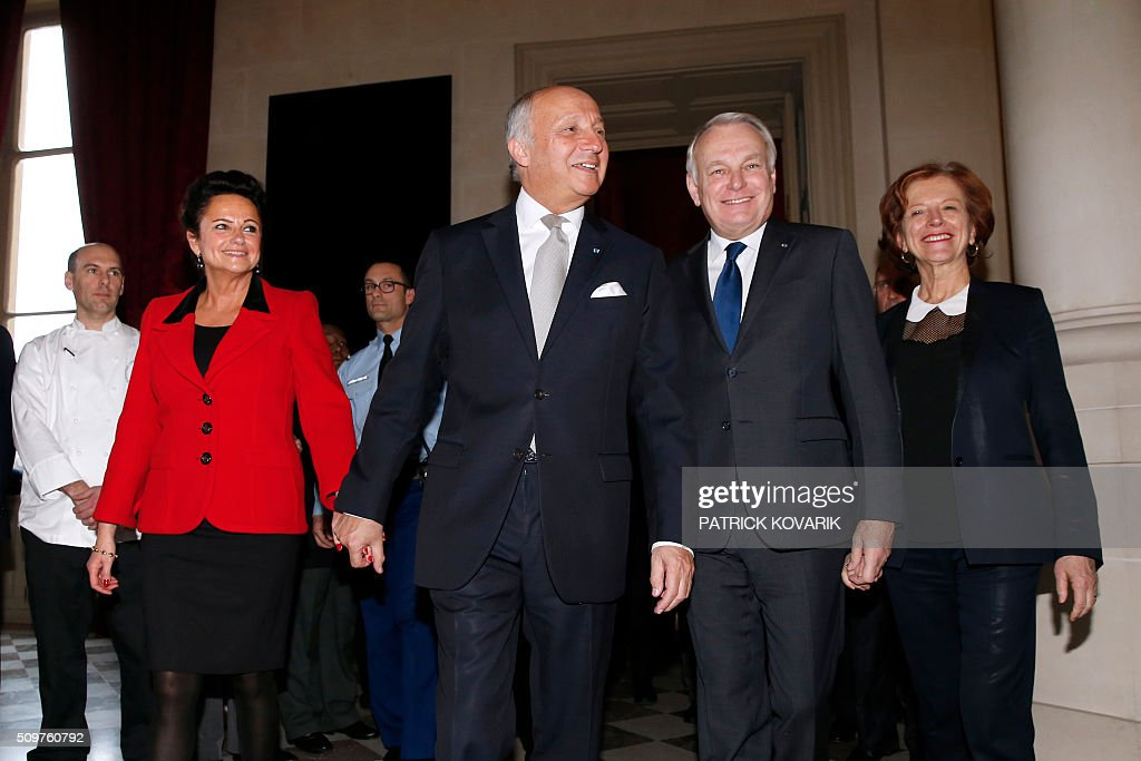 Newly appointed French Foreign Minister Jean-Marc Ayrault (2nd R), his wife Brigitte Ayrault (R) escort France's outgoing Foreign Minister Laurent Fabius (C) and his companion Marie-France Marchand-Baylet following the handover ceremony at the Foreign Ministry on February 12, 2016 in Paris. French President Francois Hollande reshuffled his cabinet on February 11, 2016, naming Jean-Marc Ayrault foreign minister and adding several ecologists to government as he seeks to widen his political base ahead of a presidential poll in 2017. / AFP / PATRICK KOVARIK