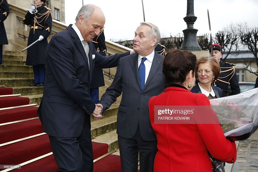 Newly appointed French Foreign Minister Jean-Marc Ayrault (2nd L), his wife Brigitte Ayrault (R) escort France's outgoing Foreign Minister Laurent Fabius (L) and his companion Marie-France Marchand-Baylet following the handover ceremony at the Foreign Ministry on February 12, 2016 in Paris. French President Francois Hollande reshuffled his cabinet on February 11, 2016, naming Jean-Marc Ayrault foreign minister and adding several ecologists to government as he seeks to widen his political base ahead of a presidential poll in 2017. / AFP / PATRICK KOVARIK