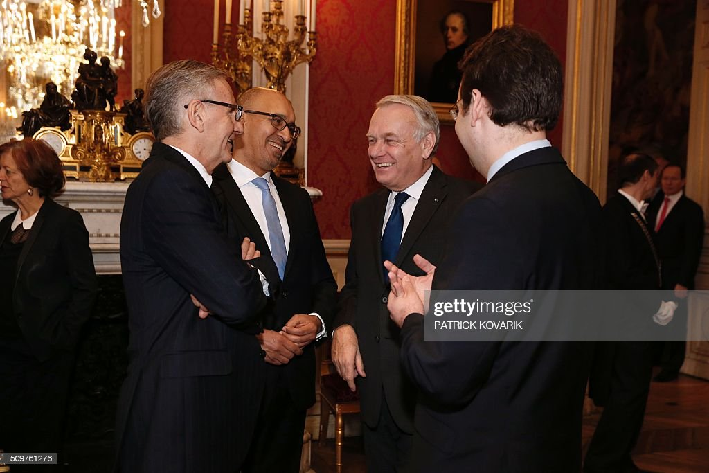 Newly appointed French Foreign Minister Jean-Marc Ayrault (2nd R) talks with (From L) the French Minister of State for Development and Francophony, Andre Vallini, the French Minister of State for European Affairs, Harlem Desir and the French Minister of State for Foreign Trade, the Promotion of Tourism and French Nationals Abroad, Matthias Fekl following the handover ceremony at the Foreign Ministry on February 12, 2016 in Paris. French President Francois Hollande reshuffled his cabinet on February 11, 2016, naming Jean-Marc Ayrault foreign minister and adding several ecologists to government as he seeks to widen his political base ahead of a presidential poll in 2017. / AFP / PATRICK KOVARIK