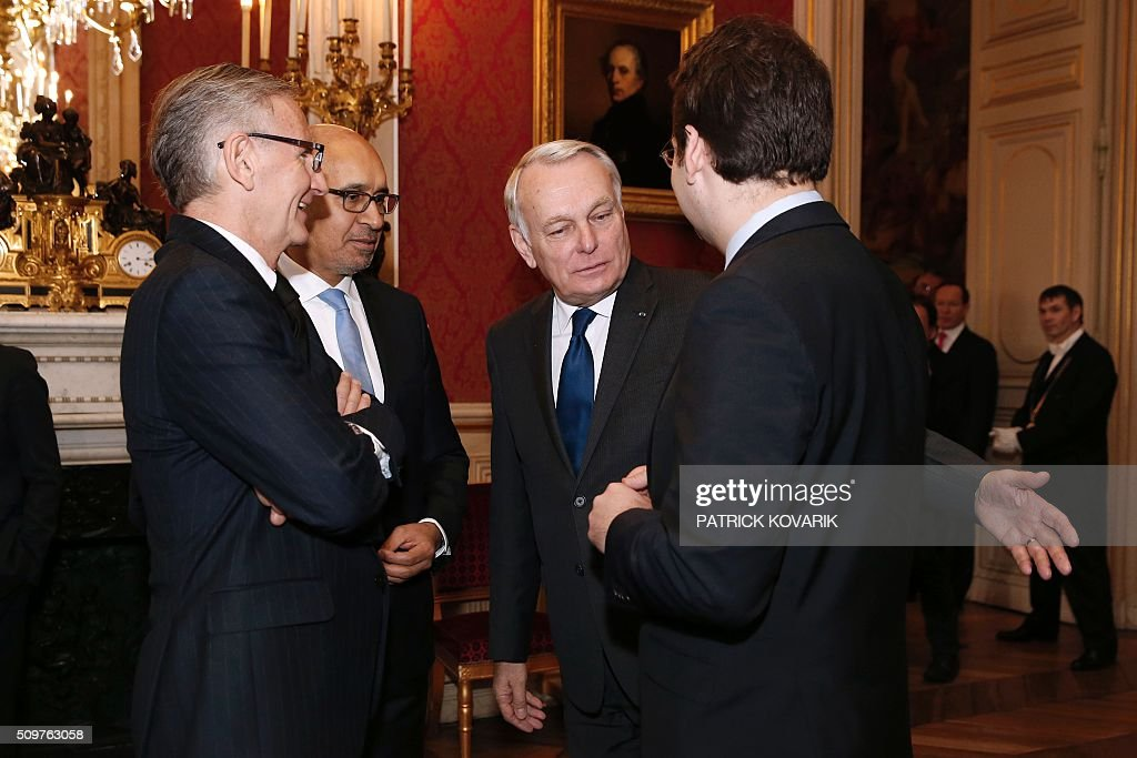 Newly appointed French Foreign Minister Jean-Marc Ayrault (C) talks with (From L) the French Minister of State for Development and Francophony, Andre Vallini, the French Minister of State for European Affairs, Harlem Desir and the French Minister of State for Foreign Trade, the Promotion of Tourism and French Nationals Abroad, Matthias Fekl following the handover ceremony at the Foreign Ministry on February 12, 2016 in Paris. French President Francois Hollande reshuffled his cabinet on February 11, 2016, naming Jean-Marc Ayrault foreign minister and adding several ecologists to government as he seeks to widen his political base ahead of a presidential poll in 2017. / AFP / PATRICK KOVARIK