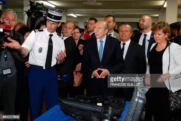 Newly appointed French Interior Minister Gerard Collomb listens to an explanation as he visits the departmental gendarmerie in SaintGermainenLaye...