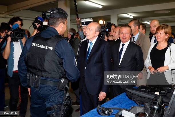 Newly appointed French Interior Minister Gerard Collomb shakes hands with a gendarme as he visits the departmental gendarmerie in SaintGermainenLaye...