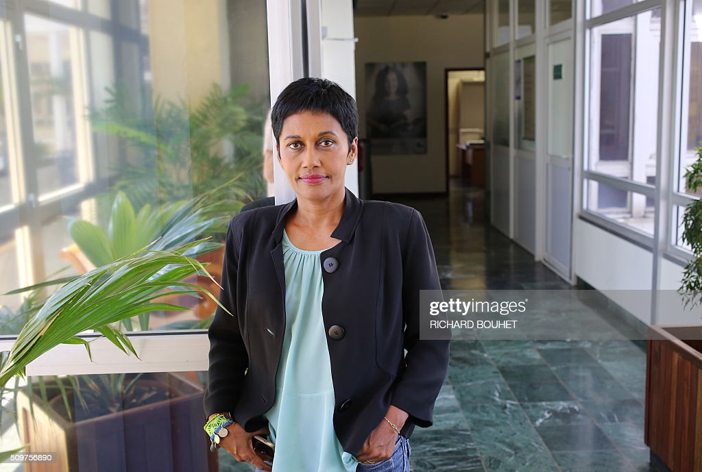 Newly appointed French Minister of State for Real Equality, Ericka Bareigts poses at the city hall in Saint-Denis de la Reunion on February 12, 2016. Bareigts was named Minister of State for Real Equality on February 11, 2016 as French President Francois Hollande reshuffled his cabinet, naming Jean-Marc Ayrault foreign minister and adding several ecologists to government as he seeks to widen his political base ahead of a presidential poll in 2017. / AFP / RICHARD BOUHET