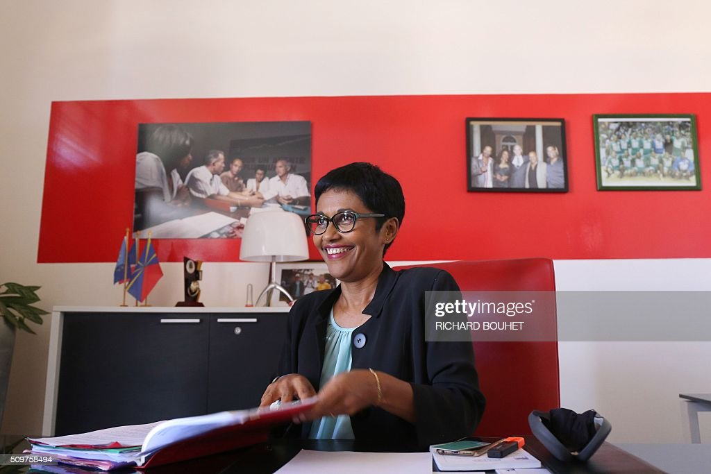 Newly appointed French minister of State for Real Equality, Ericka Bareigts smiles on February 12, 2016 in her office at the Saint-Denis de la Reunion City Hall where she is city coucillor. Bareigts was named Minister of State for Real Equality on February 11, 2016 as French President Francois Hollande reshuffled his cabinet, naming Jean-Marc Ayrault foreign minister and adding several ecologists to government as he seeks to widen his political base ahead of a presidential poll in 2017. / AFP / RICHARD BOUHET